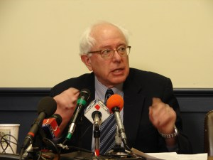 Then-Representative (and Senator-elect) Bernie Sanders (I-Vt.) speaks to the press. Hillary Clinton did not beat Sanders. She rooked Sanders. (S)he who counts the votes...!