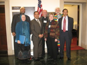 Keith Ellison, the Muslim pol, poses with misguided clergy in an ironic context.