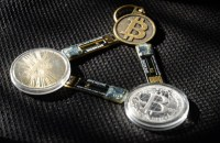 BitCoin as a keychain. Kelly Loeffler is hot and heavy with BitCoin, which is not your friend.