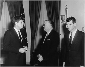 Religion and politics collided during the campaign of President John F. Kennedy, shown here with his brother Robert and J. Edgar Hoover, Director, FBI.