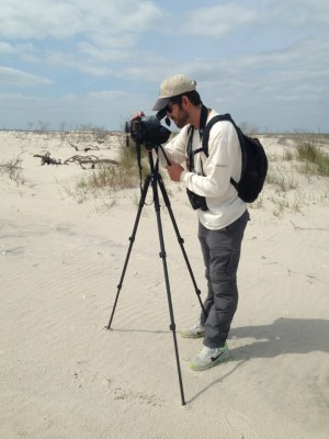 CWF Field Technician Jesse Amesbury tracking piping plovers at Holgate with his scope.