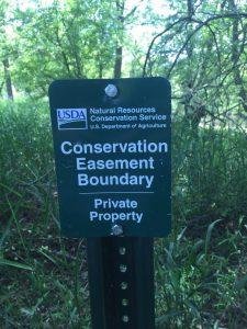 NRCS easement boundary sign.
