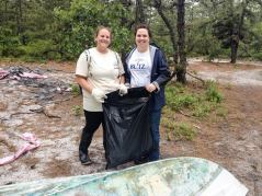 Two Women Cleaning up at Barnegat Bay