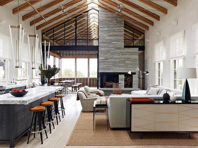 L'ambiance est lumineuse avec cette cuisine ilot central en marbre
