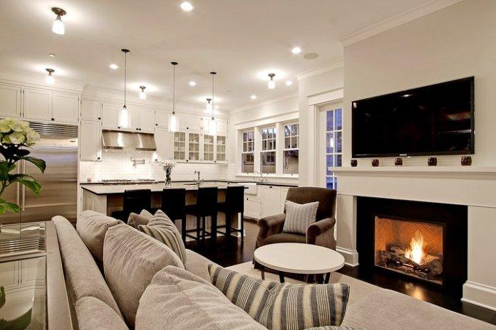 Un aménagement réussi d'une cuisine ouverte optimise et délimite les espaces.