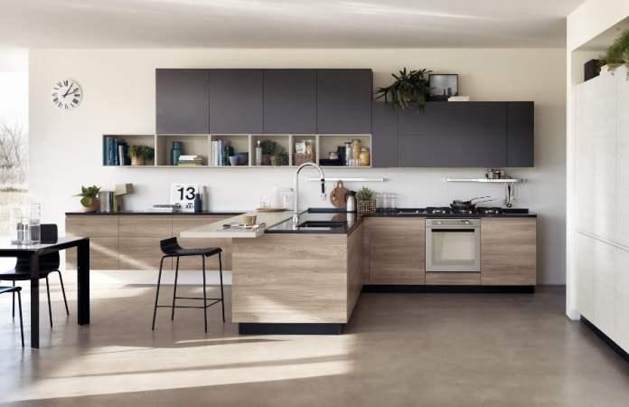 Idée d'aménagement d'une cuisine en bois moderne dans les tons sobres.
