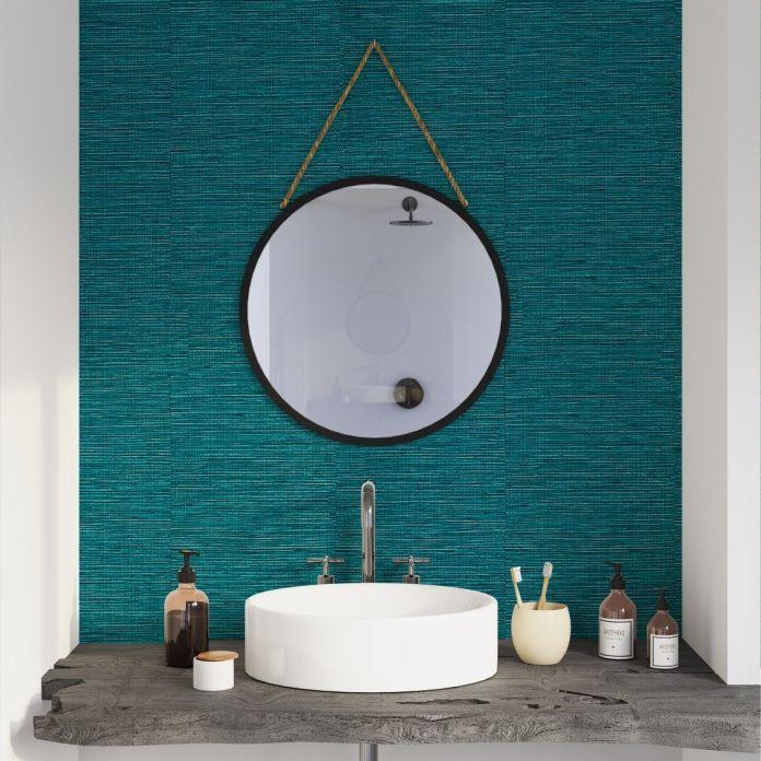 un pan de mur, devant le plan toilette, couleur bleu pétrole