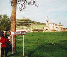The picturesque town of Castrojeriz, with a castle on the hilltop behind.