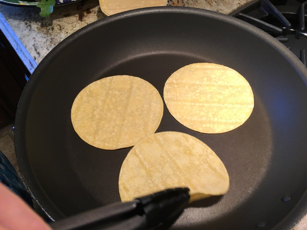 cooking tortillas for vegetarian tacos