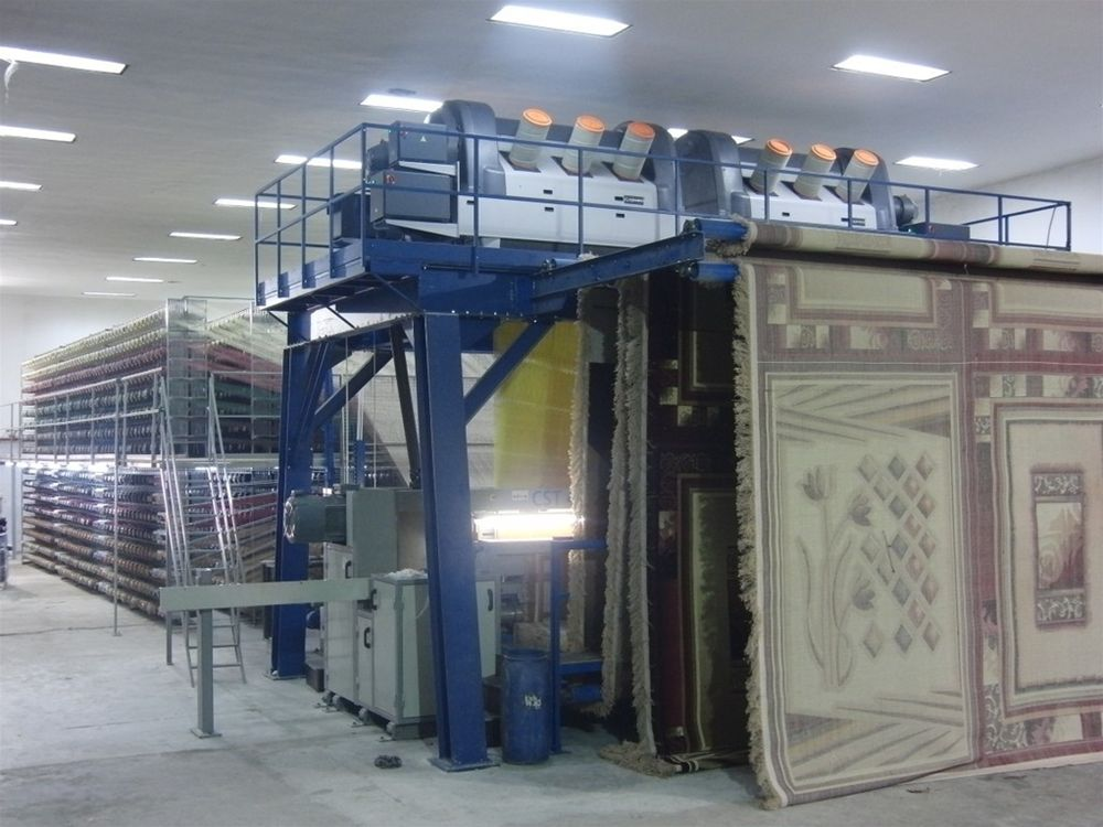 Double rapier face to face carpet weaving machine