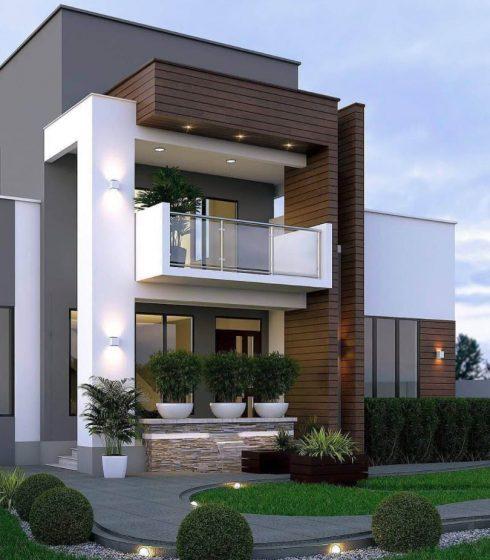 Dekoratif unsurlar ve bitkilerle zarif iki katlı ev cephesi