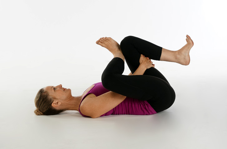 Woman in supine pigeon pose