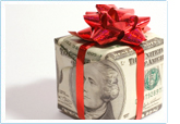 money wrapped in a red bow made to look like a gift