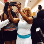 Beauty salon woman taking selfie