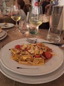 Seabass ravioli in light tomato broth cherry tomatoes and slivered almonds Ballaro Restaurant Palermo Sicily