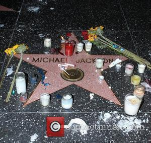 Michael Jackson 's star on The Hollywood Walk of Fame on the 1st anniversary of his death