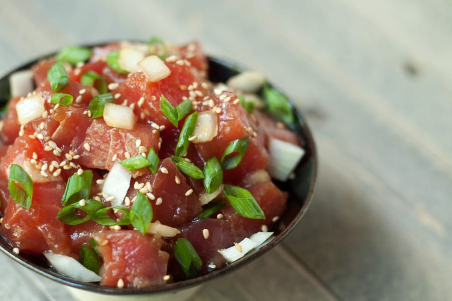 Side view close up of a bowl of ahi poke.