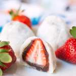 Strawbery Mochi (Daifuku)- a delicious Japanese mochi dessert. A whole strawberry is covered in a layer of red bean paste and wrapped in mochi.