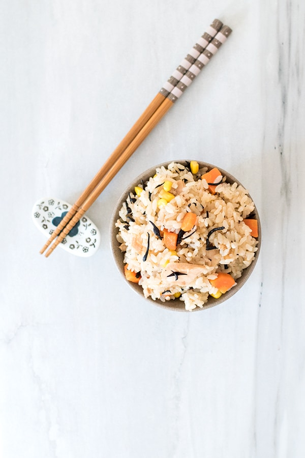 Tuna takikomi rice, or takikomi gohan, is a Japanese seasoned rice dish with veggies and tuna. Easy, filling, and nutritious, all you need to do is prep the ingredients, throw them in the rice cooker, and press start!
