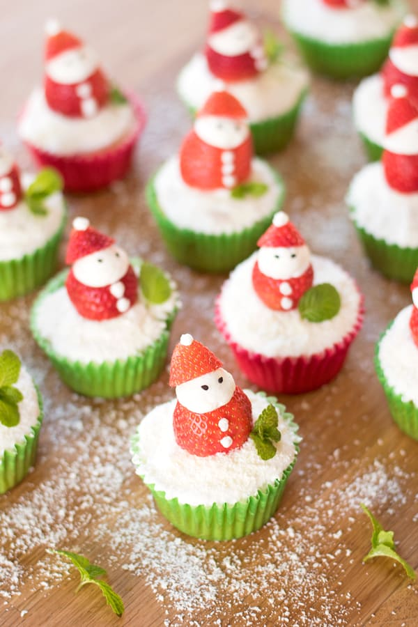 Lots of santa cupcakes lined up ready for your Christmas party!