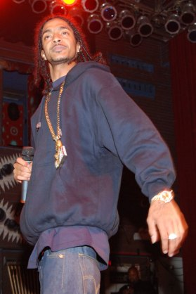 Nipsey Hussle at a performance holding a microphone