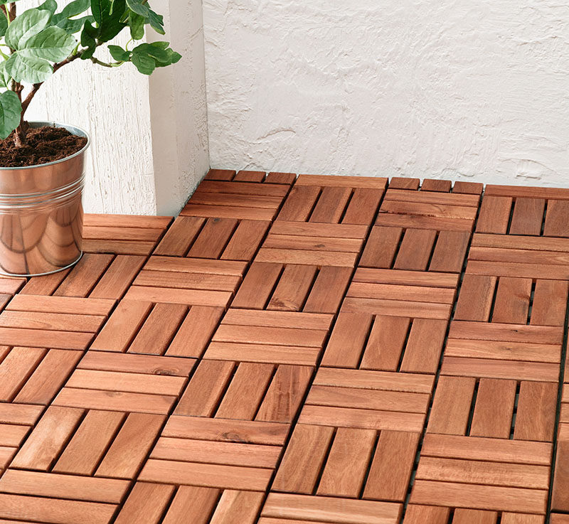 How To Make Your Balcony Awesome For Summer // Wooden floor tiles are an easy way to completely transform the look of a balcony. These modular tiles are really quick to lay, and you can take them with you if you ever move.