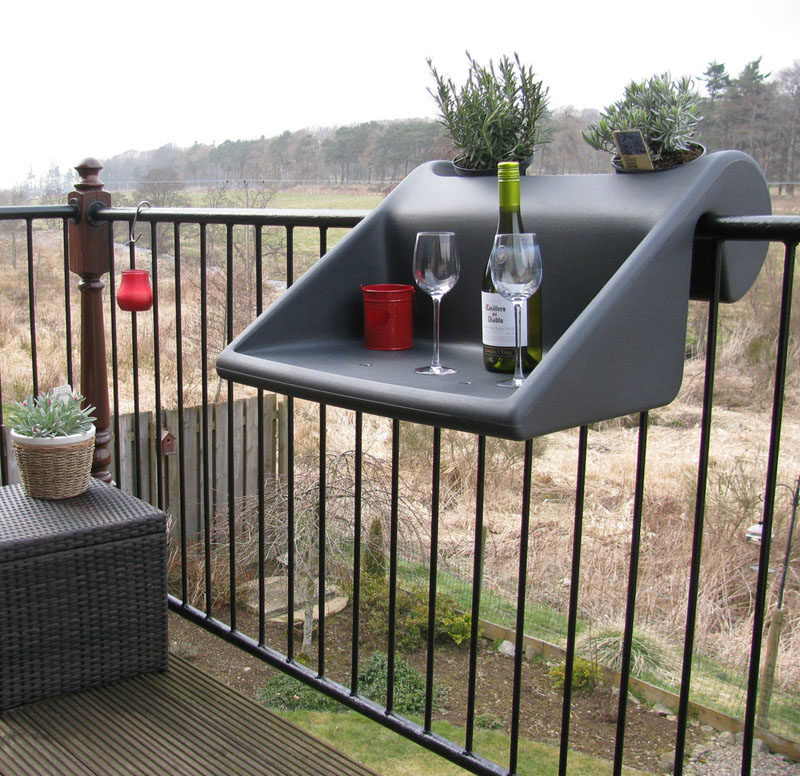 How To Make Your Balcony Awesome For Summer // You might not have enough room for a table, so consider something that can hook over the balcony railing, like this table.