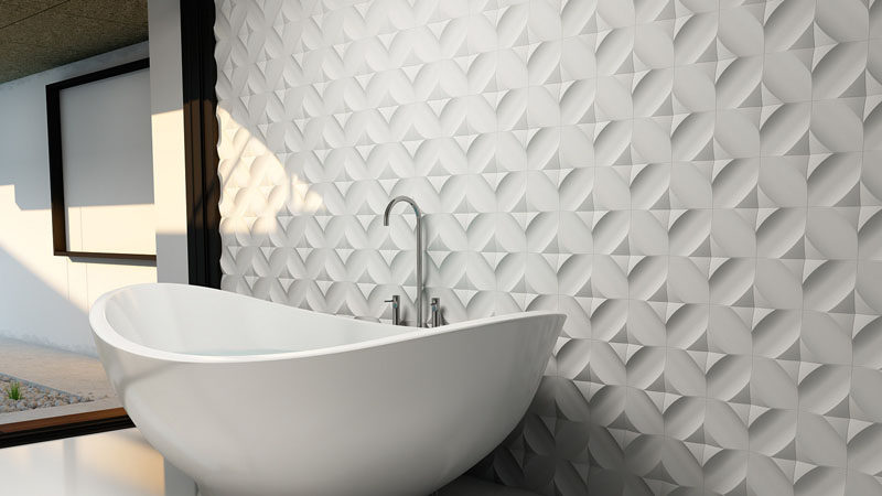 Bathroom Tile Ideas - Install 3D Tiles To Add Texture To Your Bathroom // The uniquely arranged tiles behind this bathtub create a wall full of texture and shape.
