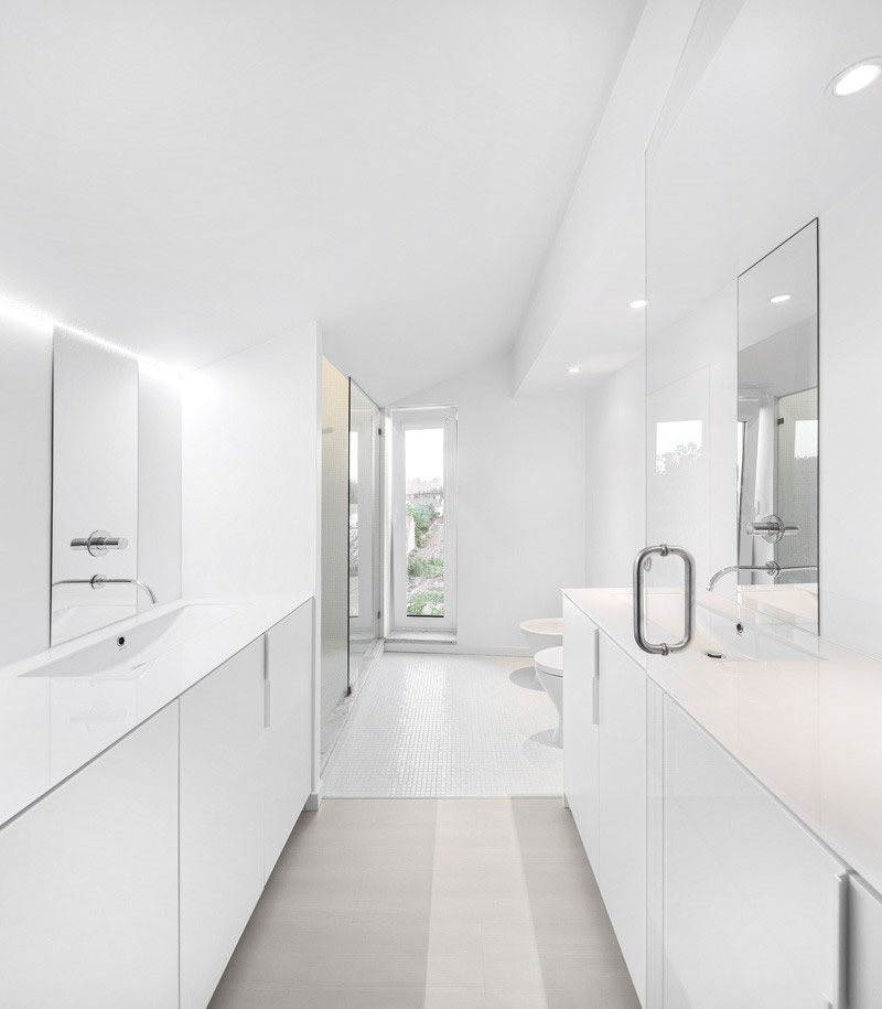 Bathroom Design Idea - Create a Spa-Like Bathroom At Home // Include crisp white walls.