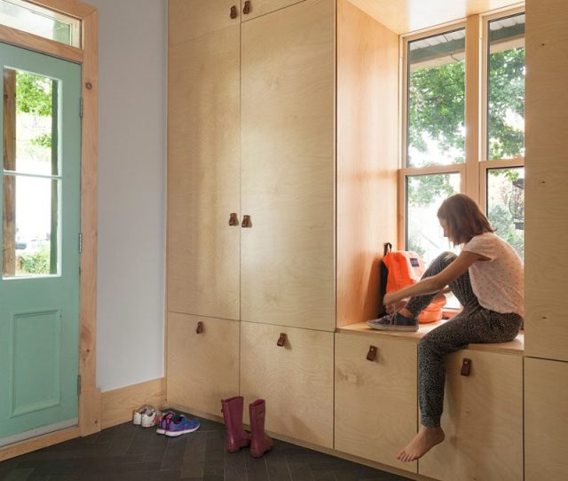 Entryway Design Ideas A Window Bench Seat Surrounded By A Wall Of Storage