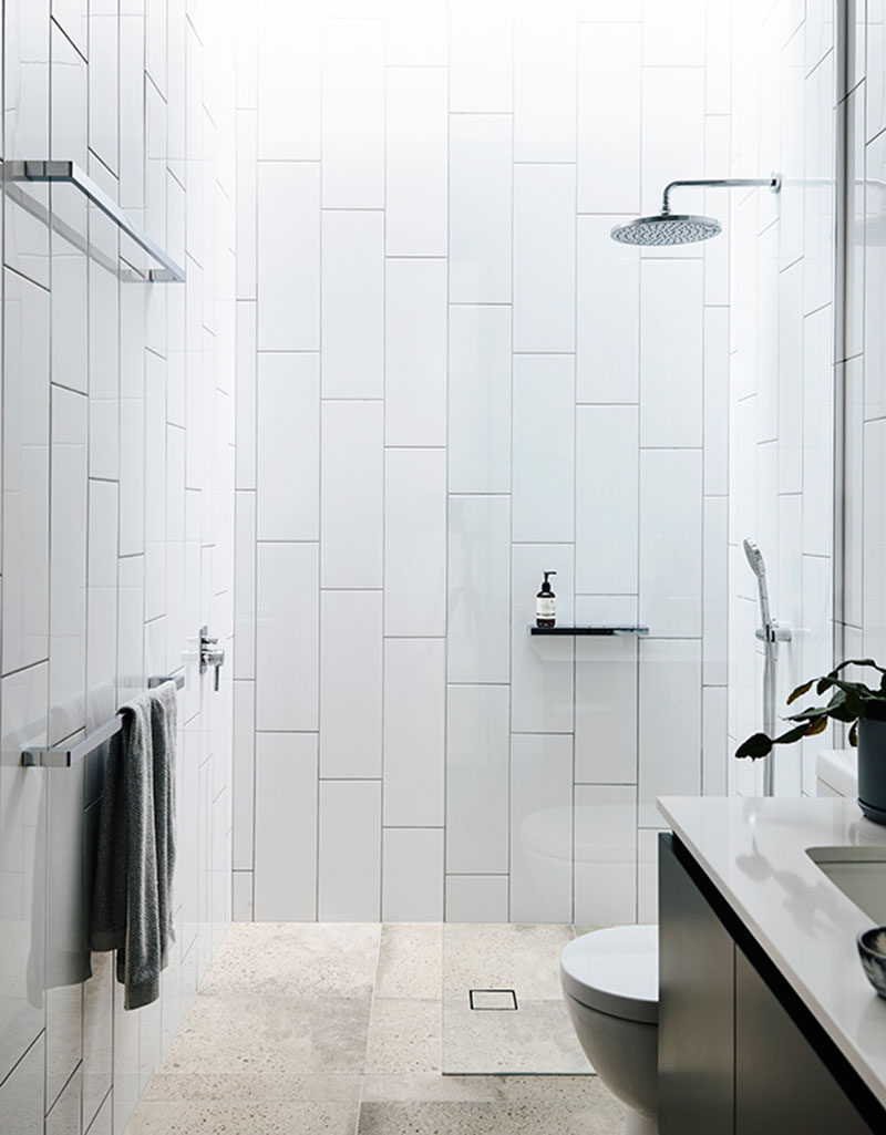 oversized subway tiles installed vertically