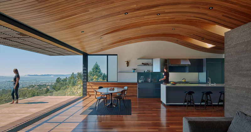 The Ceiling In This Modern House Echoes The Shape Of The