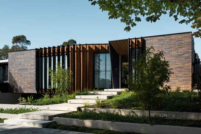 FIGR. Architecture & Design have designed this contemporary dark brick home in Australia, that wraps around a central courtyard.