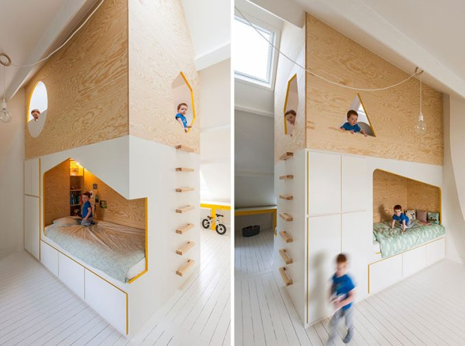 This modern kids bedroom features a custom designed wood bunk bed, each with their own desk and side of the room, and a lofted playroom.