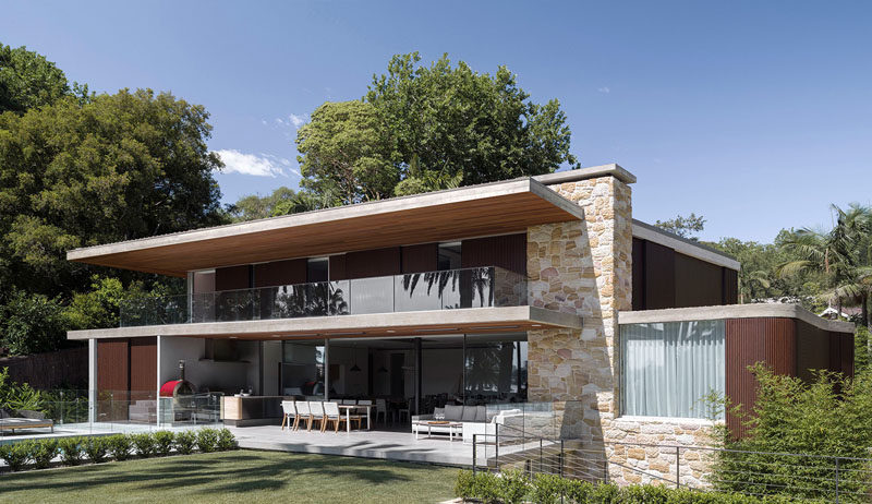 Luigi Rosselli Architects have designed a contemporary house in Sydney, Australia, that features a sandstone and wood exterior.