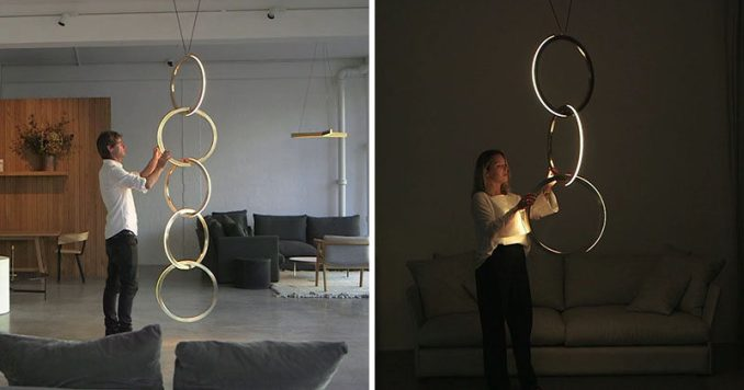 Resident Studio have designed Circus, an elegant and modern vertical pendant light collection. The length of the light can vary as the lighting system can have two to six interconnected brass rings that use embedded LED lights, and a plug and play system to produce warm light.