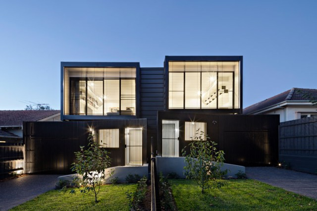 These modern townhouses are nearly identical, however they are set at different heights.