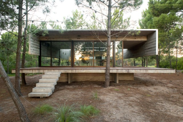 This modern concrete home has two levels separating the social areas from the sleeping areas.