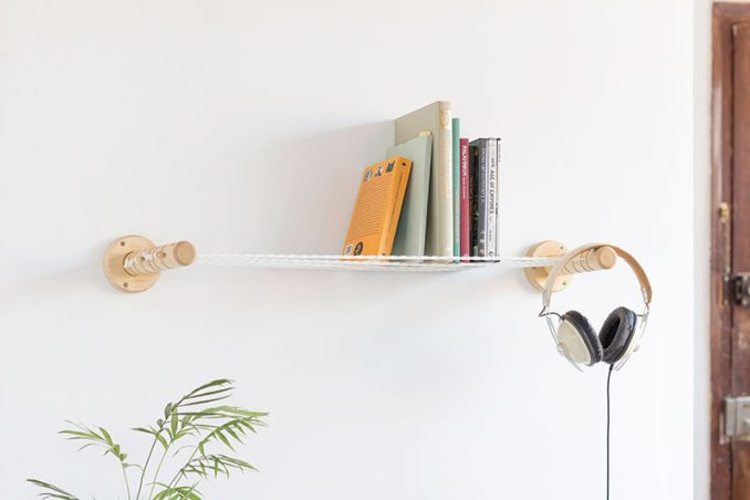The team behind Spanish design studio Smallgran, have created a unique and simple shelf design that adds an interesting look to your walls. Instead of having solid shelves made from wood or metal, the shelf has ropes that have been pulled tight between two wood ends, to create a surface that allows objects to be displayed on them.