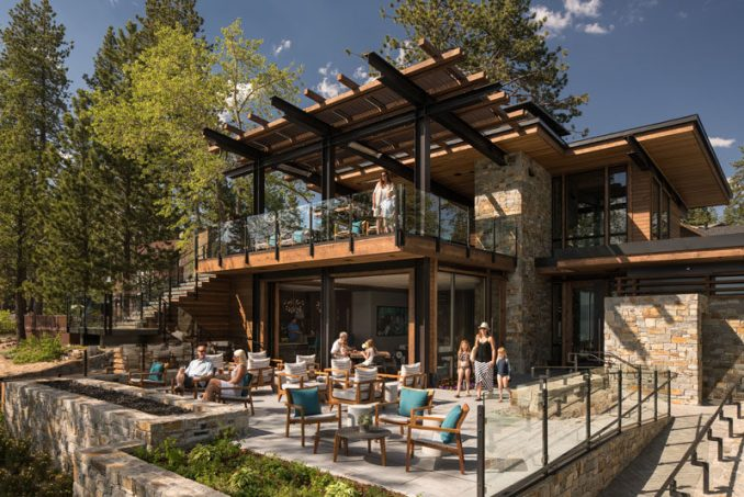 This modern club house on Lake Tahoe uses materials like ledgestone and cedar wood to evoke a warm and welcoming feeling, that when combined with steel and glass, they come together to create a contemporary appearance.