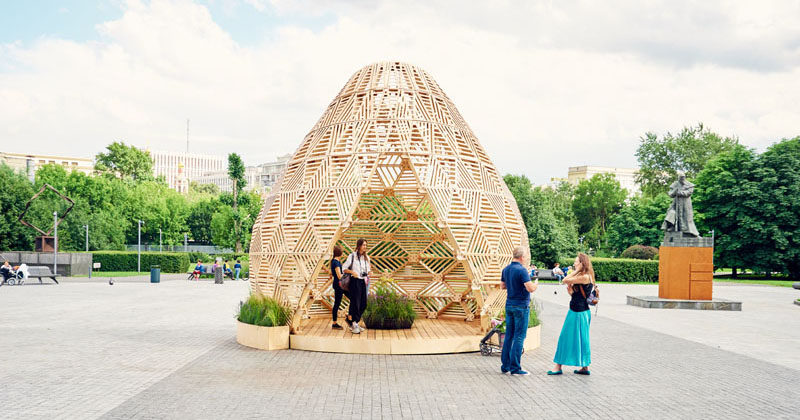Russian designer Vlad Kissel, has created a modern wood pavilion in Moscow, Russia, that has a drop like shape and references early Slavonic aesthetics.