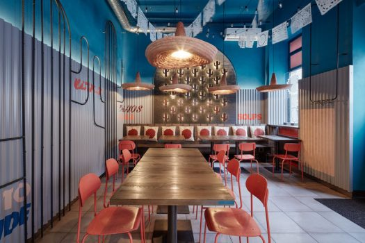 This modern Mexican restaurant features cacti motifs throughout, like mini cacti on the wall that are backlit and the wire-frame cacti artwork on the wall. #RestaurantDesign #InteriorDesign #Cacti