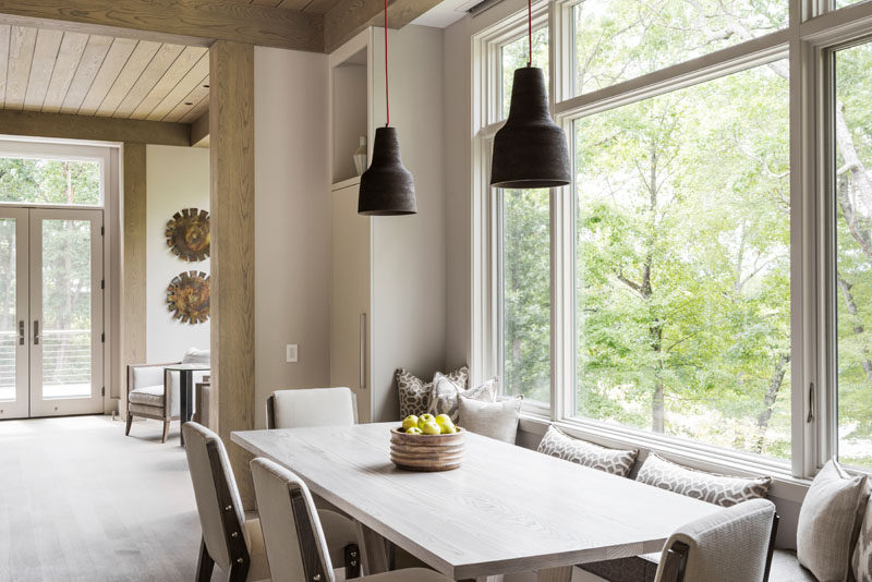 This narrow dining table has a dining table with a built-in window seat. #DiningTable #DiningRoom