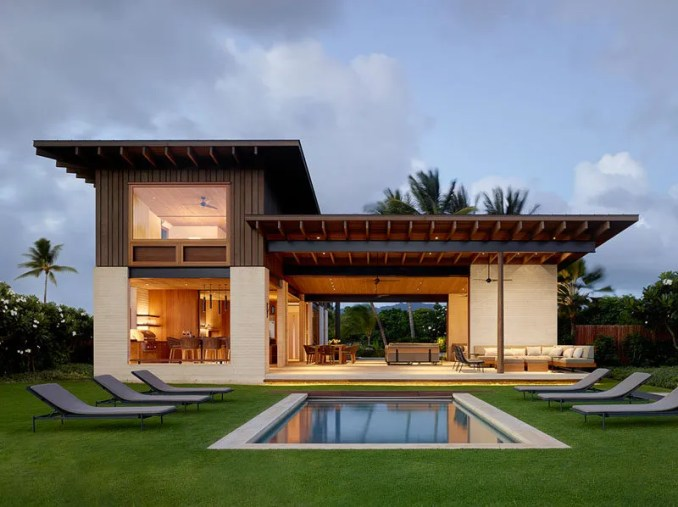 Walker Warner Architects together with Stone Interiors, have completed Hale Nukumoi, a modern beach house in Kauai, Hawaii, that has an open and casual floor plan. #ModernBeachHouse #ModernArchitecture