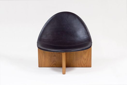 Estudio Persona have designed the Nido Chair that has an egg-like shaped leather upholstered seat that sits atop a nest of wood. #Chair #Seating #Design #Furniture