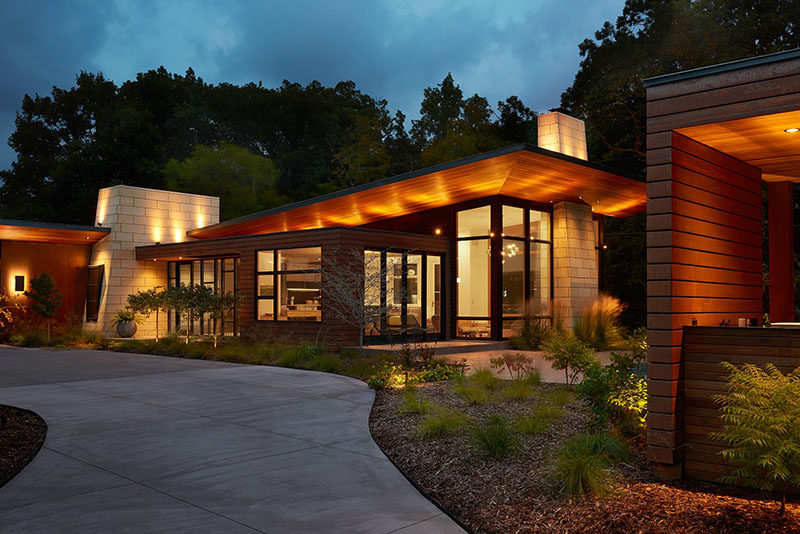 This modern ranch house uses a variety of key materials throughout its design, likeCorten Steel wall panels, natural Cedar, ground and polished concrete and Kasota limestone. #ModernRanchHouse #ModernArchitecture #HouseDesign