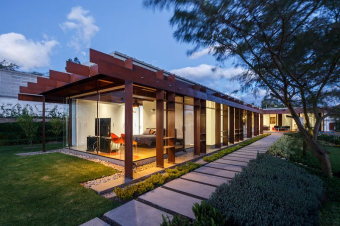 Arquitectura x have designed a modern steel and glass house for a family in Quito, Ecuador, that has a large garden and an outdoor living area. #SteelHouse #ModernHouse