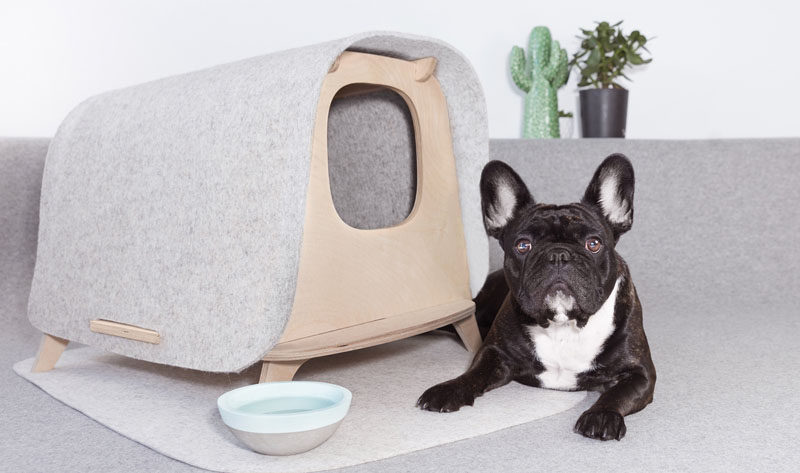 The Wool Lodge is a modern multipurpose piece of pet furniture that can be used as a cat's litter box or as a cat and dog bed. It's made in France from plywood and merino wool. Click through to see more photos and more information. #DogFurniture #StylishDogBed #ModernDogBed