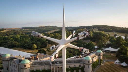 Artist Gerry Judah has designed the 2018 Goodwood Festival Of Speed sculpture that stands 52m high and has six arms that hold an iconic Porsche road or race car. #Sculpture #Art #Cars