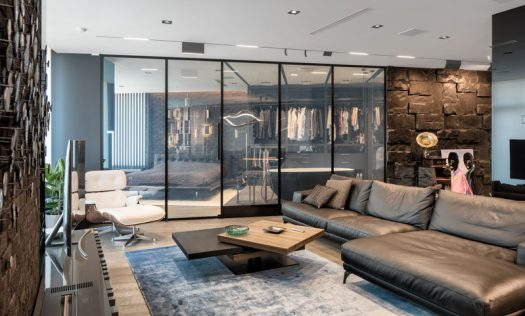 This modern apartment has a 'smart glass' wall that can transform the glass from being transparent to opaque. #SmartGlass #GlassWall #Apartment #interiorDesign